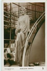 MADELEINE CARROLL  full length, descending stairs