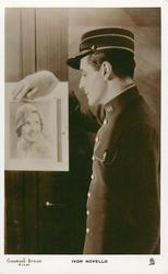 IVOR NOVELLO  (IN LOVE AND LET LOVE) man looks left, down at photo about woman