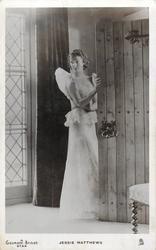 JESSIE MATTHEWS  in evening dress prepares to leave, hand on door
