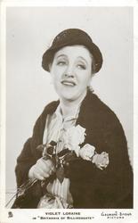 "VIOLET LORAINE IN ""BRITANNIA OF BILLINGSGATE""  faces left, looks right, with three roses"