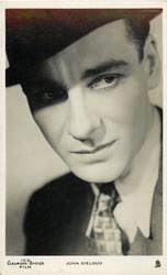 JOHN GIELGUD  faces slightly left, looks front, wears suit, hat, tie