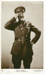 "CYRIL MAUDE IN ""ORDERS IS ORDERS""  wears soldier uniform, holds monocle with right hand"
