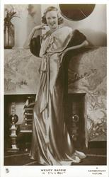 "WENDY BARRIE IN ""IT'S A BOY""  full length study, she wears silk dress, smiles"