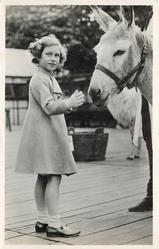 H.R.H. THE PRINCESS MARGARET ROSE AT THE ZOOLOGICAL GARDENS  petting donkey