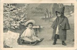 A HAPPY CHRISTMAS  boy in winter pulls a younger child right on sled, Xmas tree left