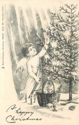 A HAPPY CHRISTMAS  angel stands on ladder reach up into Xmas tree