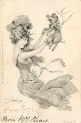 A MERRY CHRISTMAS  nouveau lady throws small pig up in the air