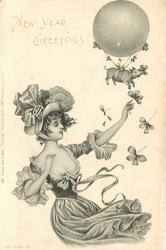 NEW YEAR GREETINGS  nouveau lady releases small pig tied under balloon