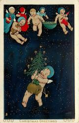 CHRISTMAS GREETINGS  baby angels fly with toys above one with muff & tree