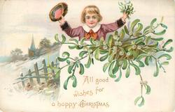 ALL GOOD WISHES FOR A HAPPY CHRISTMAS boy in purple shirt hold up hat & mistletoe behind mistletoe, snowy rural scene left