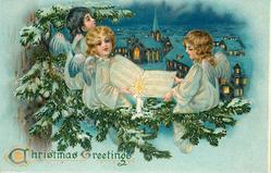 CHRISTMAS GREETINGS  three angels sit in fir tree singing, open sheet music, town below
