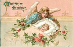 CHRISTMAS GREETINGS  angel watches over child asleep in basket facing left, holly around