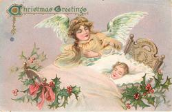 CHRISTMAS GREETINGS  angel watches over child asleep in bed facing left, holly right and below bed