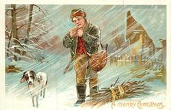 A MERRY CHRISTMAS  man lights pipe in snowstorm, dog to his left, bundle of sticks to his right