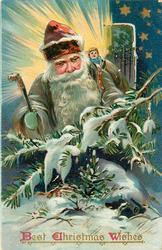 BEST CHRISTMAS WISHES  gray robed Santa, cane in right hand, brown hat, doll in toy-sack behind, night scene