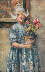 Dutch girl in blue dress standing holding flower pot of geraniums