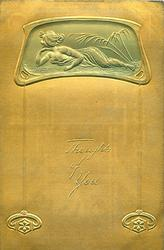 pose in roughly oblong medallion at top of card, she lies prone facing left with chin supported on her right hand, plant right