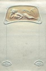 pose in roughly oblong medallion at base of card, she lies prone facing left with chin supported on her right hand, plant right