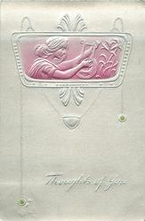pose in wide almost oblong medallion at top of card, she is playing old style lyre, lilies right