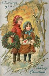 WISHING YOU A HAPPY CHRISTMAS  two girls in snowy wood carrying holly wreath & bag of presents