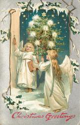CHRISTMAS GREETINGS  one angel pulls bell pull, another carries lighted tree right