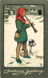 CHRISTMAS GREETINGS  man plays old style wind instrument, dog  at his side in the snow