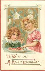 TO WISH YOU A HAPPY CHRISTMAS  two girls eat tarts