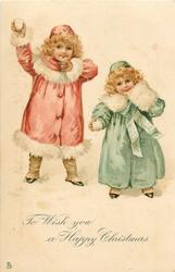 TO WISH YOU A HAPPY CHRISTMAS  two girls in winter clothes with snowballs