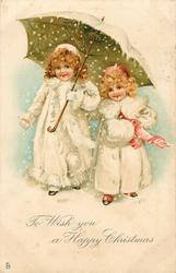 TO WISH YOU A HAPPY CHRISTMAS  two girls under umbrella in snow