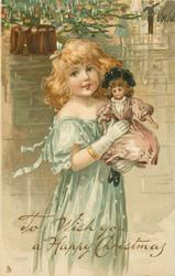 TO WISH YOU A HAPPY CHRISTMAS  girl in green gown holds up doll
