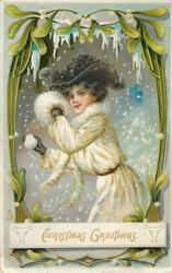 CHRISTMAS GREETINGS, girl in white coat with fur trim, muff in one hand  & snowball in the other