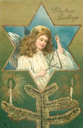 inset in gilt bordered star angel holding musical triangle, candles & evergreen below