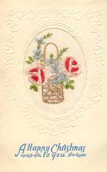 A HAPPY CHRISTMAS TO YOU  wicker basket inset, two pink/red roses, one each sides, and blue forget-me-nots