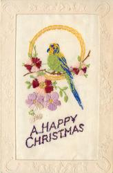 A HAPPY CHRISTMAS  parrot on circle stand & flowers