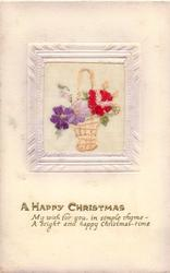 A HAPPY CHRISTMAS  on gilt, wicker basket inset with handle, flowers