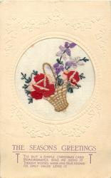 THE SEASONS GREETINGS  wicker basket tilted left inset with two pink/red roses and violets