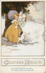 CHRISTMAS MORNING girl and dog carrying presents in snow