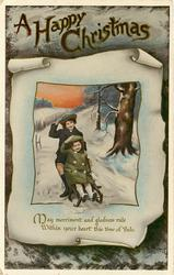 A HAPPY CHRISTMAS two girls on toboggan