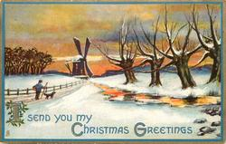 I SEND YOU MY CHRISTMAS GREETINGS  man and dog walk away on snowy road, windmill back