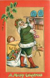 A MERRY CHRISTMAS  at bottom, green robed Santa stuffs stocking, boy peeks from behind chest