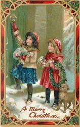 A MERRY CHRISTMAS  two girls & dog on doorstep before green door