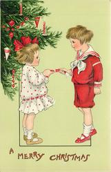 A MERRY CHRISTMAS  girl left, boy right, face each other and pull cracker, tree left