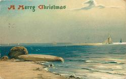 A MERRY CHRISTMAS ocean scene, large flat rock and a round one on shore to left, distant sailboats, sea right