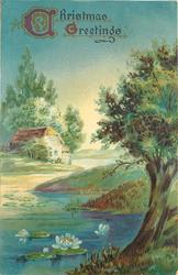 CHRISTMAS GREETINGS  rural scene, tree right front, stream with flowering water lilies, building back at left