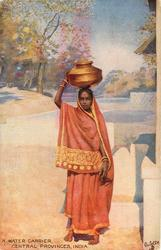 A WATER CARRIER, CENTRAL PROVINCES, INDIA