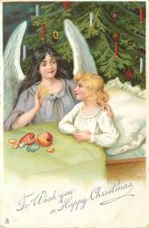 TO WISH YOU A HAPPY CHRISTMAS  angel with arm around girl in bed, holds star in hand