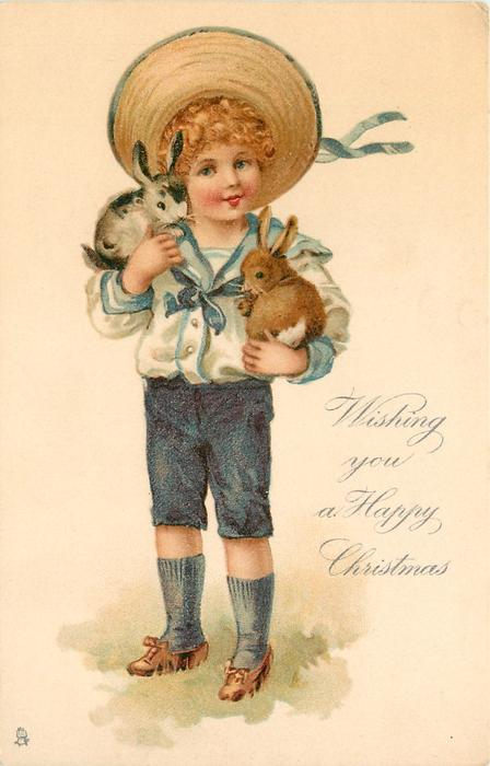 WISHING YOU A HAPPY CHRISTMAS  boy holds two rabbits in his arms