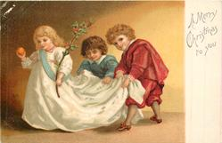 A MERRY CHRISTMAS TO YOU  girl walks left holding orange & holly, her train lifted by two pages