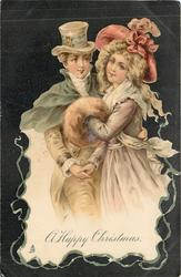 A HAPPY CHRISTMAS elaborately dressed couple embrace, holding right hands front
