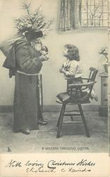WITH LOVING CHRISTMAS WISHES  A WELCOME CHRISTMAS VISITOR  child kneels on chair talking to Santa
